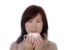 Asian Businesswoman With Cup. Beautiful Young Asian (Chinese) Businesswoman With White Coffee Cup royalty free stock images