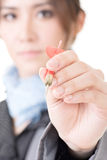 Asian businesswoman with dart in hand Stock Photos