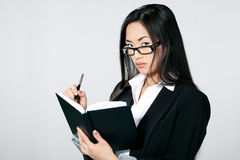 Asian businesswoman with diary Stock Photos