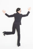 Asian businesswoman facing and leaning wall Royalty Free Stock Photo