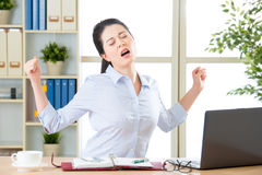 Asian businesswoman fell tired and stretching Royalty Free Stock Photo