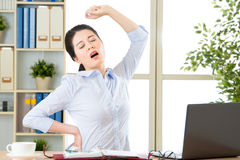 Asian businesswoman fell tired and stretching Royalty Free Stock Photography