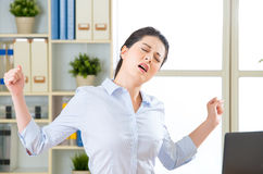 Asian businesswoman fell tired and stretching Stock Images