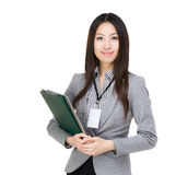Asian businesswoman with file pad and laptop Royalty Free Stock Image