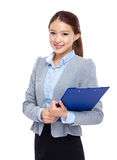 Asian businesswoman with filepad Stock Photos