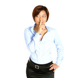 Asian businesswoman with finger on lips Royalty Free Stock Image