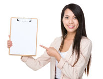 Asian businesswoman with finger point to clipboard Royalty Free Stock Photo