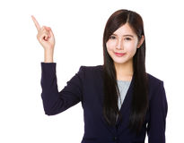 Asian businesswoman with finger pointing up Stock Images