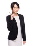 Asian businesswoman finger up Stock Photo