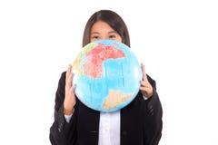 Asian businesswoman with globe Stock Photo