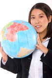 Asian businesswoman with globe Stock Photo