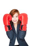 Asian businesswoman guard with boxing glove Stock Photos