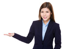 Asian businesswoman with hand showing blank area Royalty Free Stock Photo