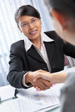 Asian businesswoman handshake with client Royalty Free Stock Image