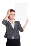 Asian businesswoman headache hold a vertical  blan Royalty Free Stock Images