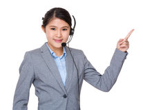Asian businesswoman with headset and finger point up Stock Photography