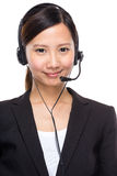 Asian businesswoman with headset Royalty Free Stock Photography
