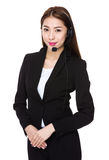 Asian businesswoman with headset Royalty Free Stock Image