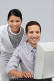 Asian businesswoman helping her colleague Royalty Free Stock Image