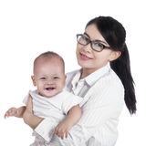 Asian businesswoman and her baby royalty free stock photography