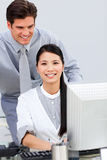 Asian businesswoman and her colleague working Royalty Free Stock Photos