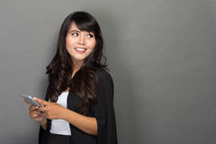 Asian businesswoman with her phone looking up Royalty Free Stock Photography