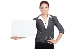 Asian businesswoman hold a blank sign and arms aki Stock Photos