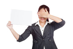 Asian businesswoman hold a blank sign close her ey Royalty Free Stock Images