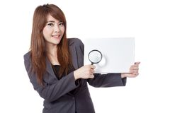 Asian businesswoman hold blank sign and  magnifying glass Stock Photo