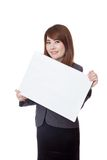 Asian businesswoman hold blank sign obliquely Stock Images