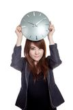 Asian Businesswoman hold a clock over her head Royalty Free Stock Photography