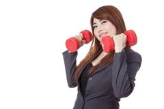Asian businesswoman hold dumbbells with her both hand Stock Photo