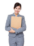 Asian businesswoman hold with file pad Royalty Free Stock Image