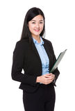 Asian businesswoman hold with file pad Royalty Free Stock Images
