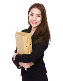 Asian Businesswoman hold with folder Stock Photo