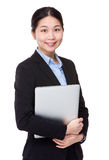 Asian Businesswoman hold with portable computer Royalty Free Stock Image