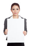 Asian businesswoman hold a vertical  blank sign Royalty Free Stock Photography
