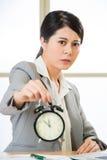 Asian businesswoman holding  alarm clock Royalty Free Stock Photos