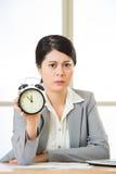Asian businesswoman holding  alarm clock Royalty Free Stock Photography
