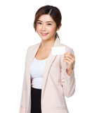Asian businesswoman holding a blank business card Royalty Free Stock Photo