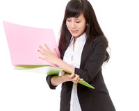 Asian office lady holding bright colored folders Royalty Free Stock Photography
