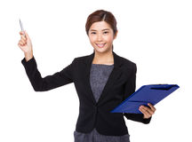 Asian businesswoman holding with clipboard and pen point up Stock Image