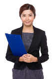 Asian businesswoman holding a file board Royalty Free Stock Photography