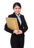 Asian businesswoman holding folder Royalty Free Stock Photos