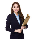 Asian businesswoman holding with folder Royalty Free Stock Images