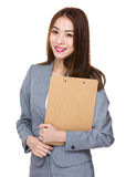 Asian businesswoman holding with folder Stock Photos