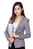 Asian businesswoman holding with laptop computer Stock Photography