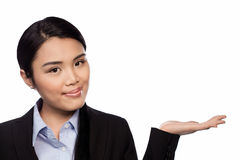 Asian businesswoman holding out her palm Royalty Free Stock Images