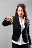 Asian businesswoman holding something Royalty Free Stock Photos
