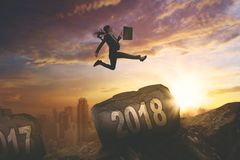 Asian businesswoman jumping above number 2018 Stock Images